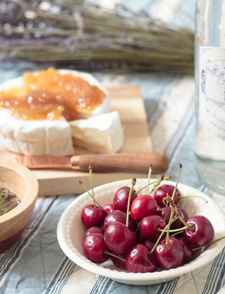 French picnic with cherries and brie with fig preserves