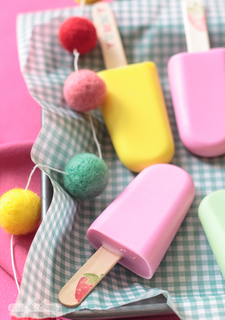 Kids will go wild for this fruity-scented popsicle-shaped easy homemade soap. You can make a batch in just 10 minutes using your microwave! These popsicle soaps are great party favors or a summertime craft with kids. #kidscrafts #homemadesoap #soapmaking #popsicles #summercrafts