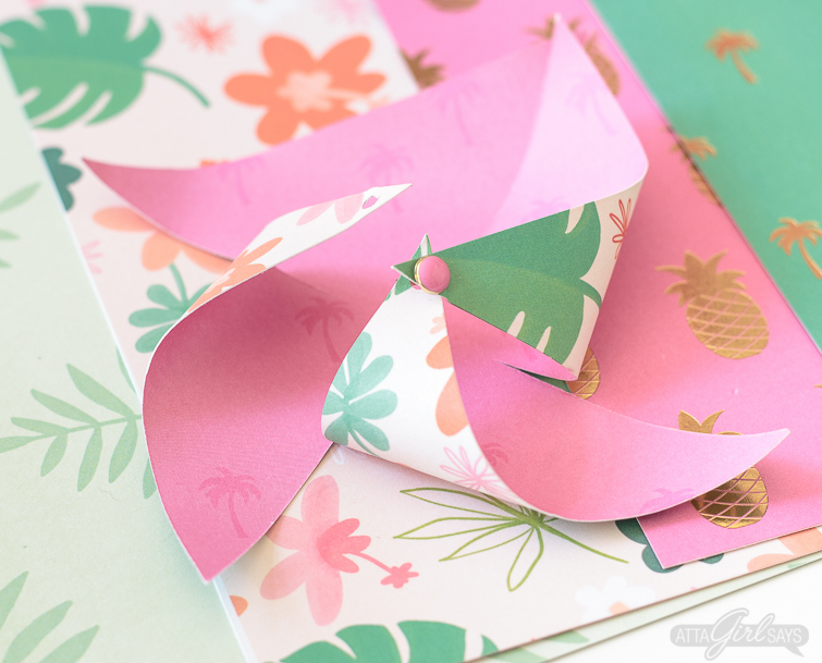 Need to add a festive touch to any occasion? Grab some pretty patterned scrapbook paper and I'll show you how to make pinwheels. They're so easy to make, even kids can help! Use your homemade pinwheels for party banners, cupcake toppers, centerpieces and more. #papercrafts #pinwheels #scrapbookpaper