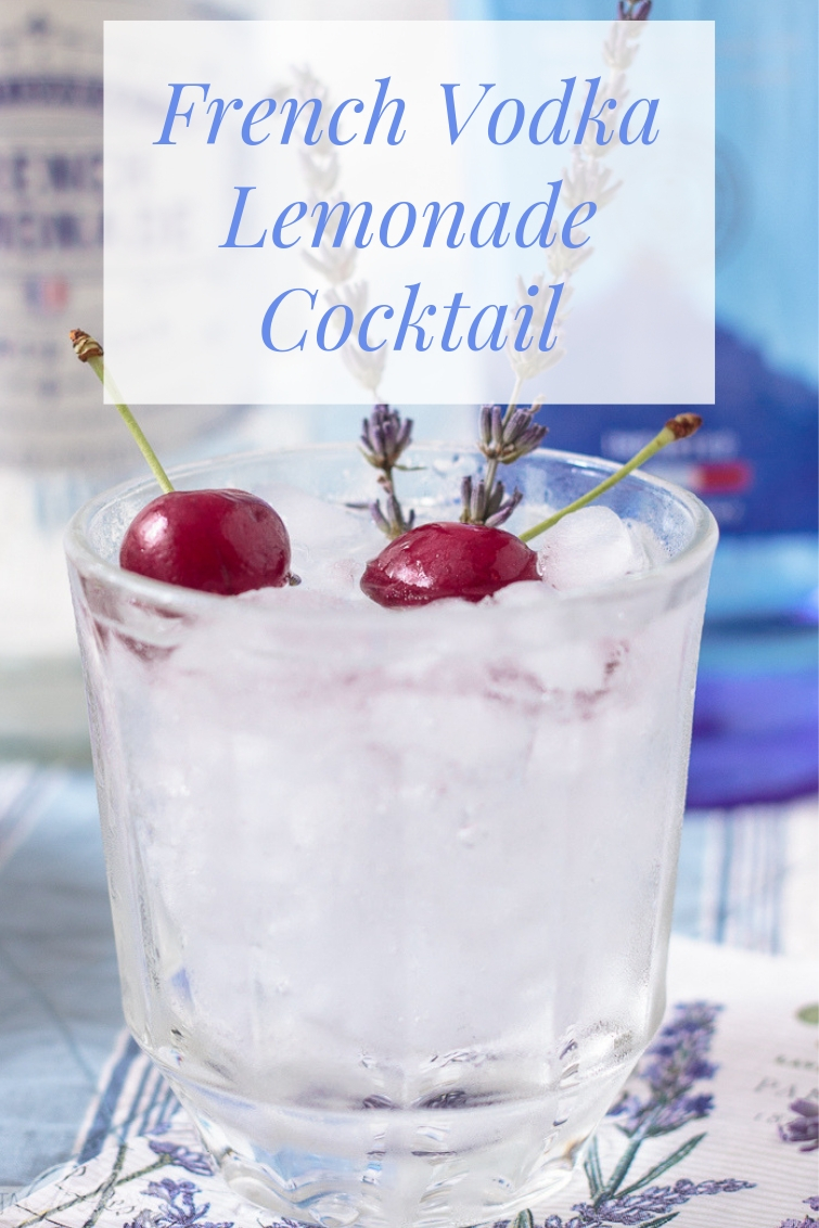 french Vodka lemonade cocktail garnished with cherries and lavender