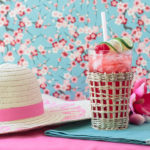 summer straw hat and a sparkling vanilla cherry cocktail