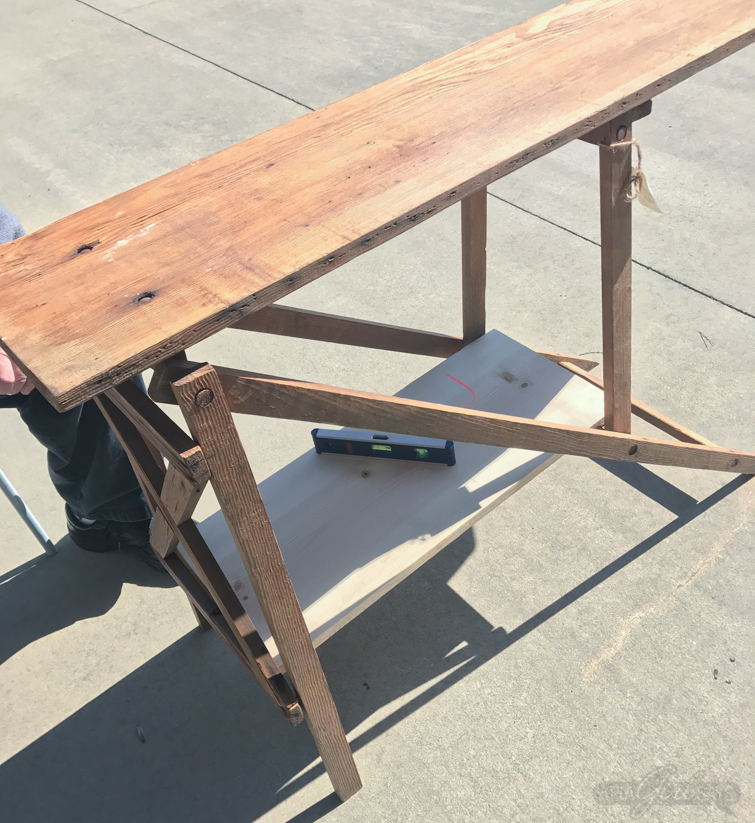 Turn an antique wooden ironing board into a console table with storage. This is an easy DIY project for beginners; a drill is the only tool you'll need. #upcycle #furniturebuilding #ironingboard #woodironingboard