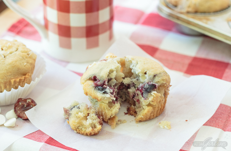 These delightfully delicious white chocolate cherry muffins are made with fresh fruit and white chocolate chips. They're delicious with coffee for breakfast, but they're sweet enough for dessert, as well.  #whitechocolate #cherries #muffins #breakfastrecipes #cherrymuffins #dessertforbreakfast