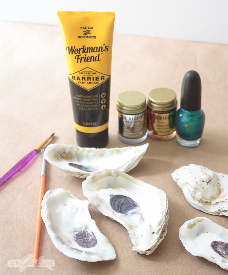 Oyster Shell Craft supplies: Oyster shells, paintbrushes, liquid leaf and metallic green fingernail polish along with a tube of Workman's Friend Barrier Skin Cream