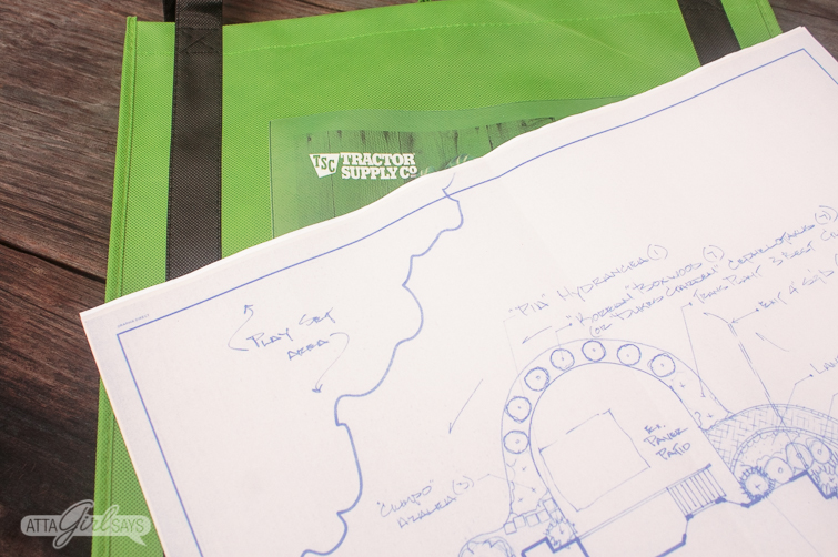 Landscaping plan sitting on a green Tractor Supply bag