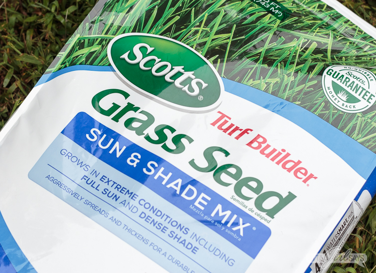 Bag off Scotts Turf Builder Grass Seed lying on grass