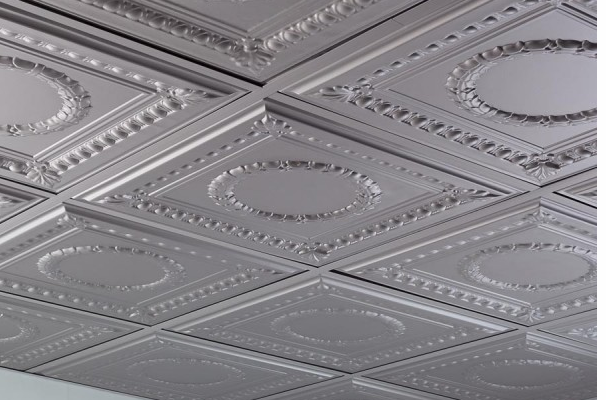 Overhead shot of a silver faux tin ceiling with a rosette design