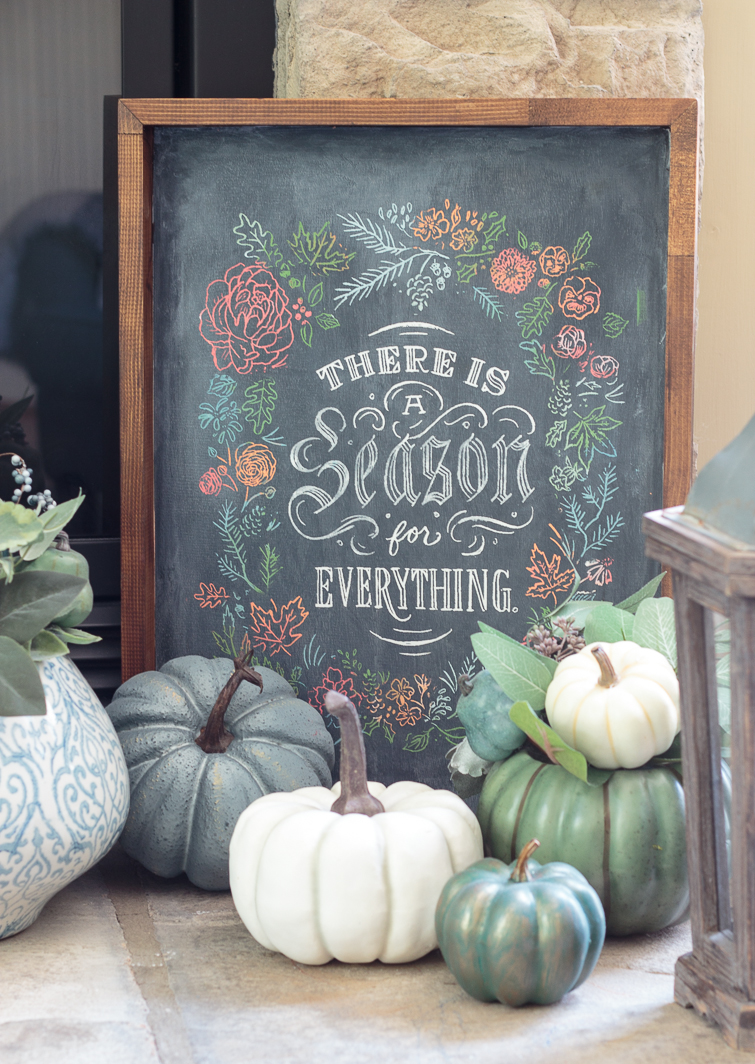 "chalkboard sign ""There is a Season for Everything"" on a heart surrounded by blue, white and aqua pumpkins"