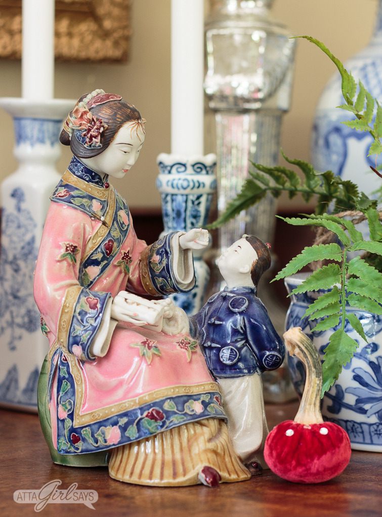 porcelain figurine of a Chinese mother and son