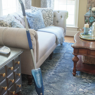 closeup photo of a Bona spray mop cleaning oak hardwood floors