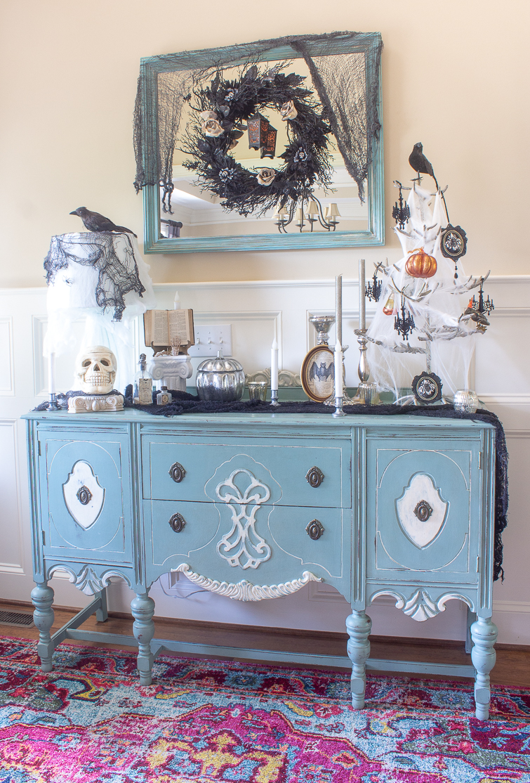 aqua blue vintage painted buffet decorated with gothic Halloween decorations