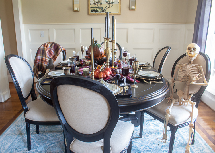 black dining table set with Halloween table decorations