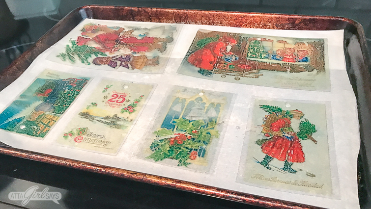 Vintage Christmas postcard Shrinky Dinks Christmas ornaments on a parchment lined baking sheet