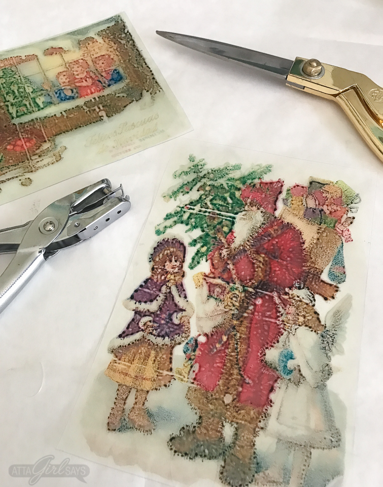 clear piece of Shrinky Dinks paper printed with an image of Santa Claus with a child from a vintage holiday postcard
