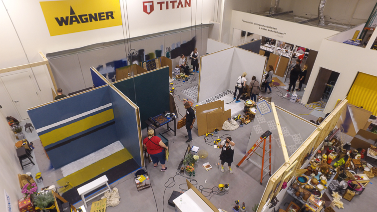 aerial shot of people participating in a White Room Design challenge in a warehouse