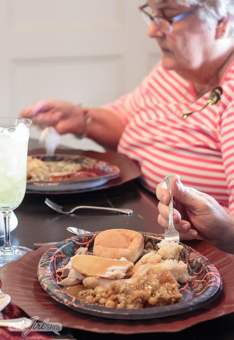 man and woman enjoying a Thanksgiving dinner
