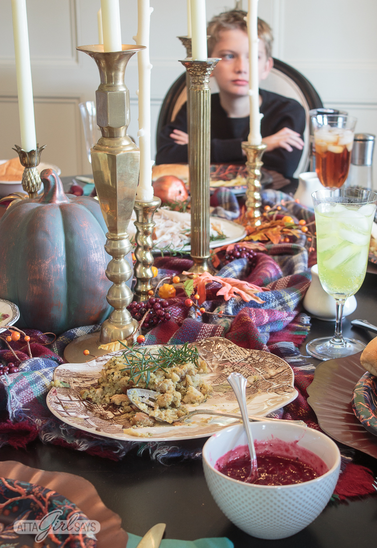 Thanksgiving table with a child seated at the head of the table