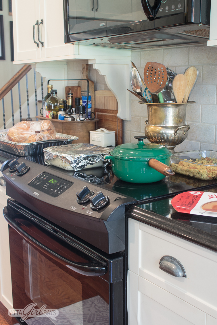 kitchen stovetop filled with pans for Thanksgiving dinner