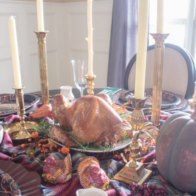 Thanksgiving table with turkey on a platter