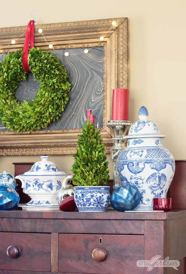 empire style buffet decorated with blue and white choinoiserie pottery for Christmas