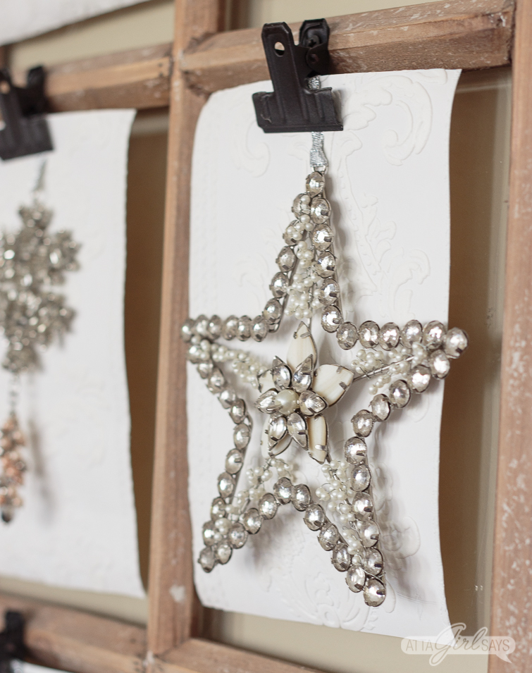jewel star ornament hanging on a window pane