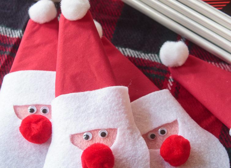 Felt Santa claus napkin rings on a holiday table