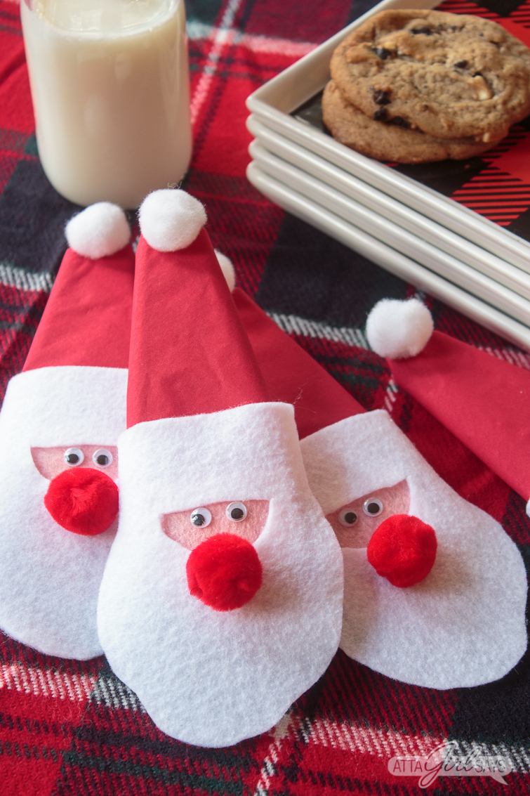 Felt Santa claus napkin rings on a holiday table