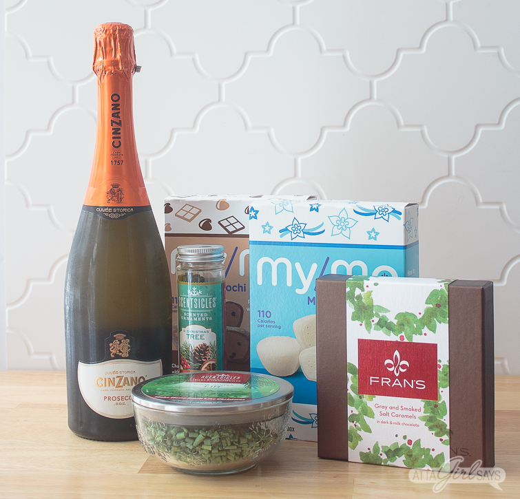 prosecco, chocolates, mochi ice cream and Scentsicles on a kitchen counter