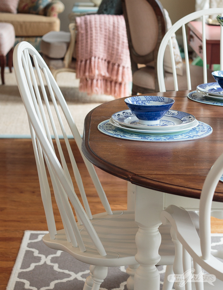 white painted Windsor dining chair at a two-tone kitchen table