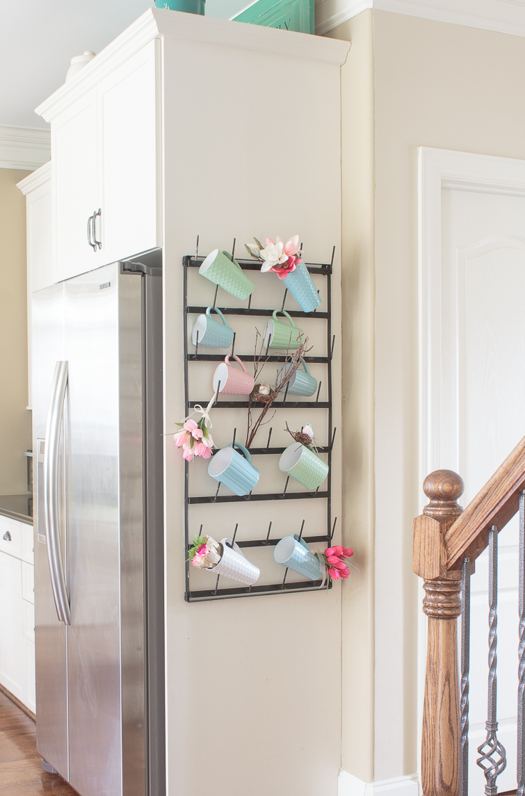 hanging coffee mug rack decorated for spring