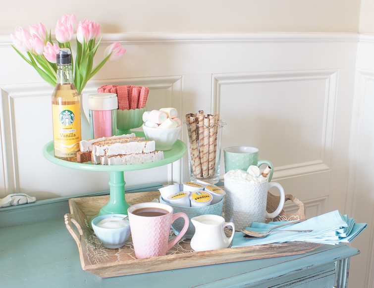coffee bar with colorful pastel mugs and serving pieces