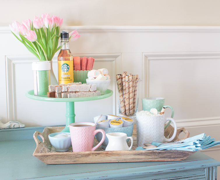 colorful spring coffee bar on a tray on a painted buffet