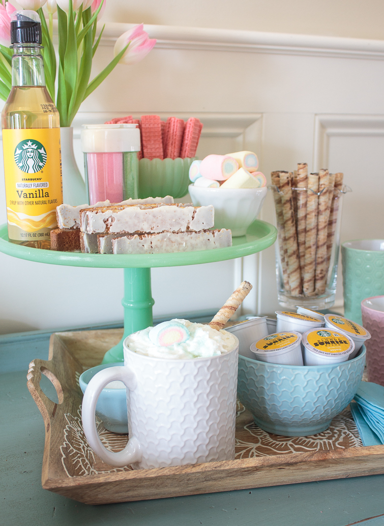 spring coffee bar set up on a tray and a jadeite cake stand