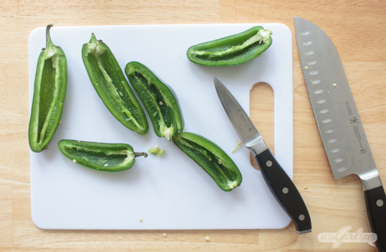 sliced jalapeno peppers on a cutting board
