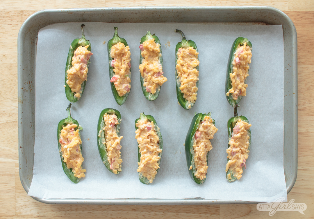 pimento cheese stuffed jalapeno peppers ready to bake