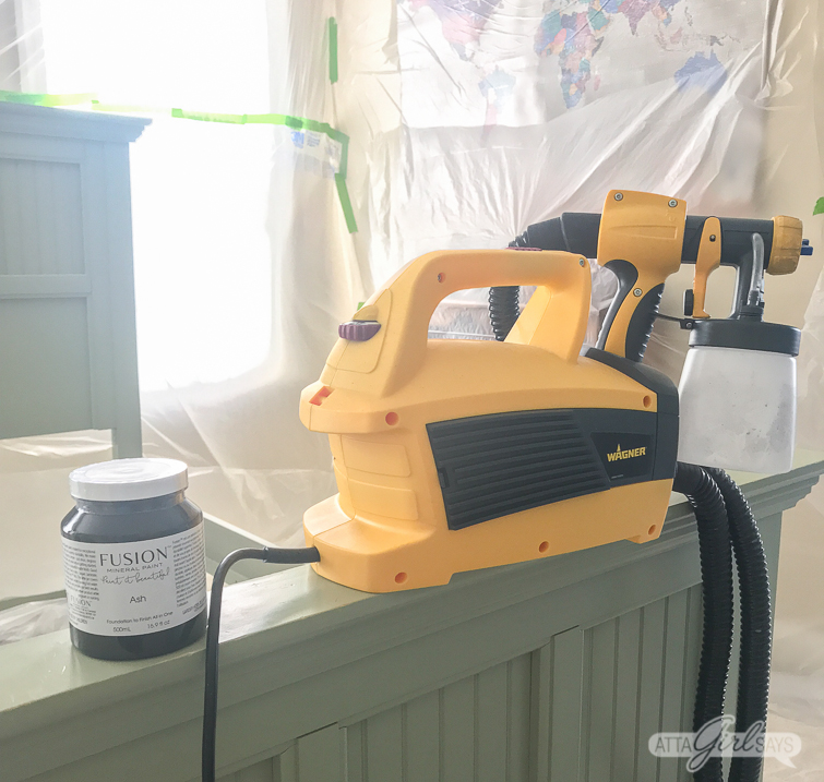 Wagner paint sprayer on a green bed frame