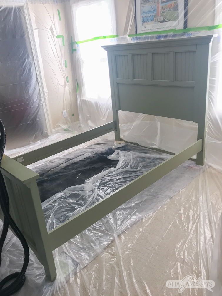 preparing to paint a bed in a indoor DIY spray booth