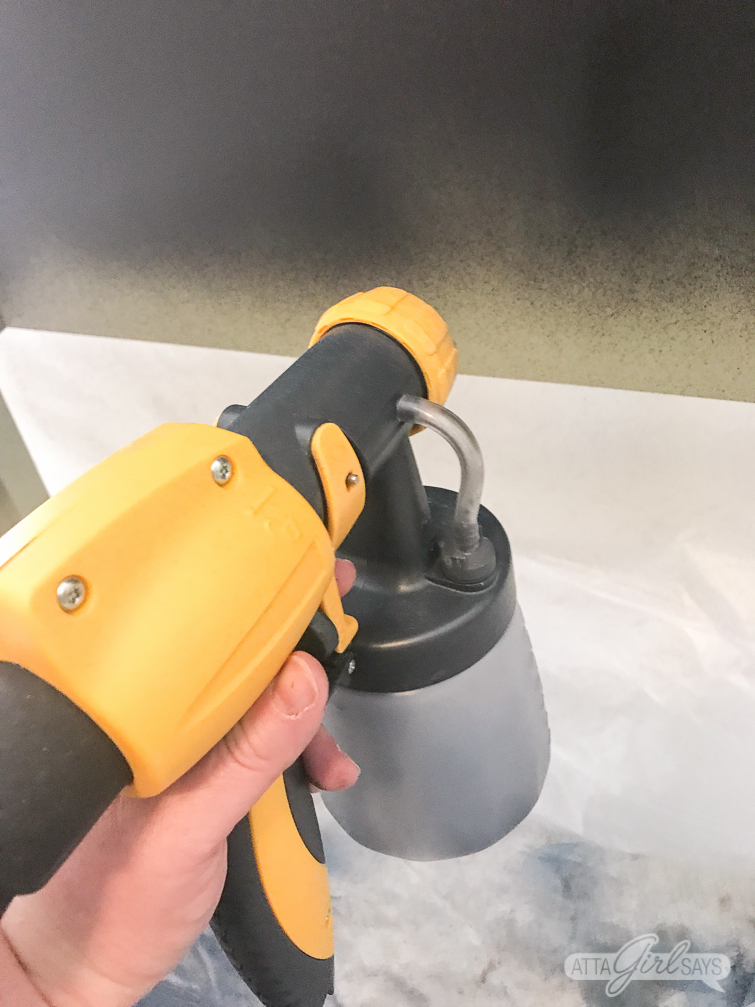 using a Wagner FLEXiO sprayer to paint a bed