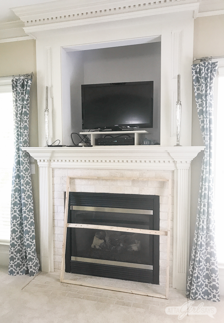 bedroom fireplace with a cubby for a TV over it