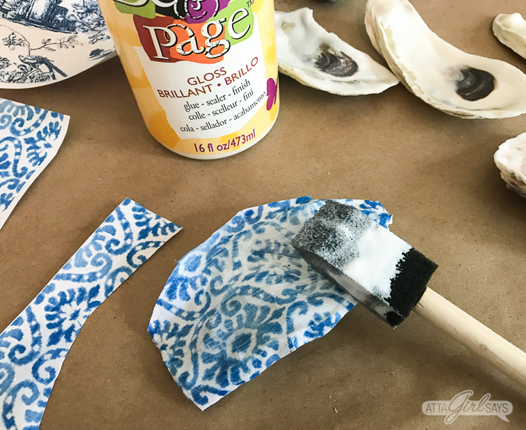 brushing decoupage medium on chinoiserie oyster shells