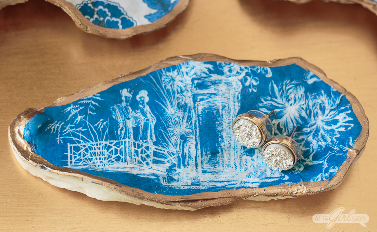 blue and white chinoiserie design on an oyster shell