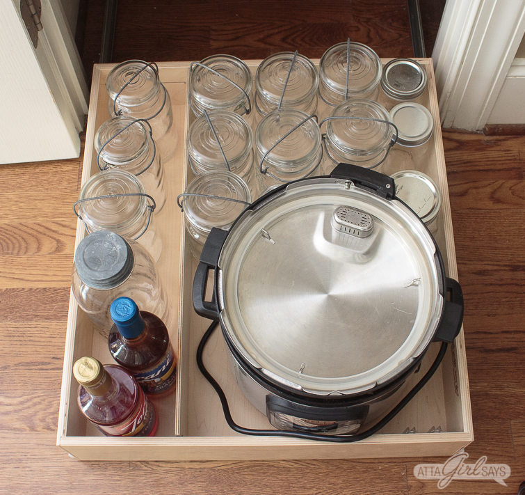 mason jars and an InstantPot on a slide-out pantry shelf