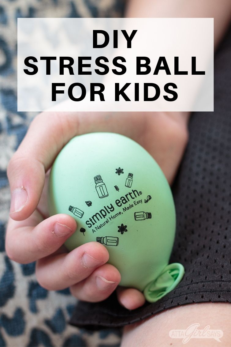 boy holding a DIY stress ball for kids made from a balloon
