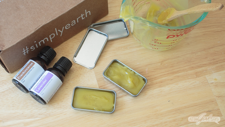 tin containers filled with DIY eye cream made with essential oils