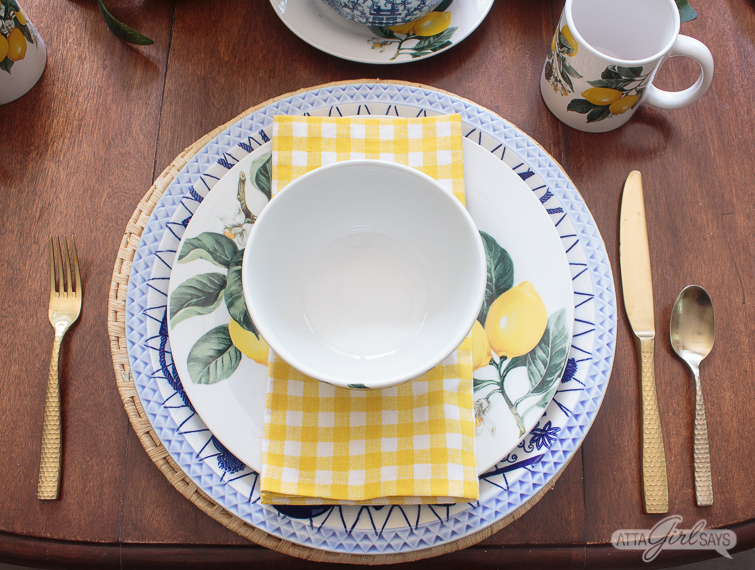 blue and lemon yellow place setting with a gingham napkin