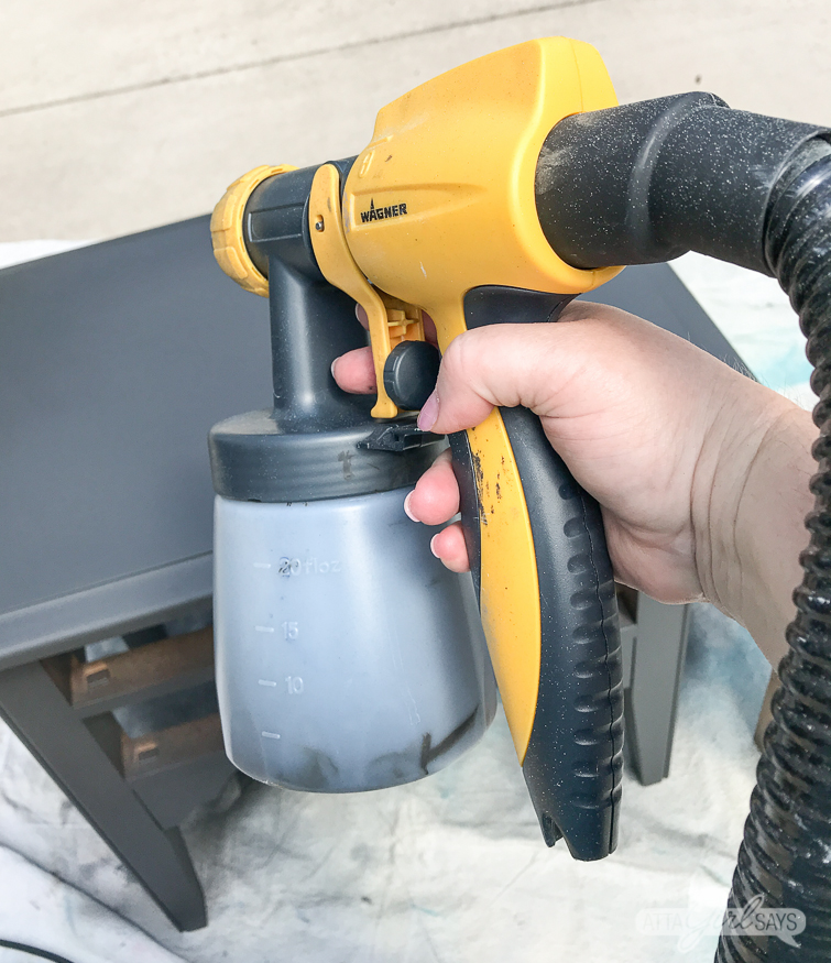 using a paint sprayer to paint a nightstand