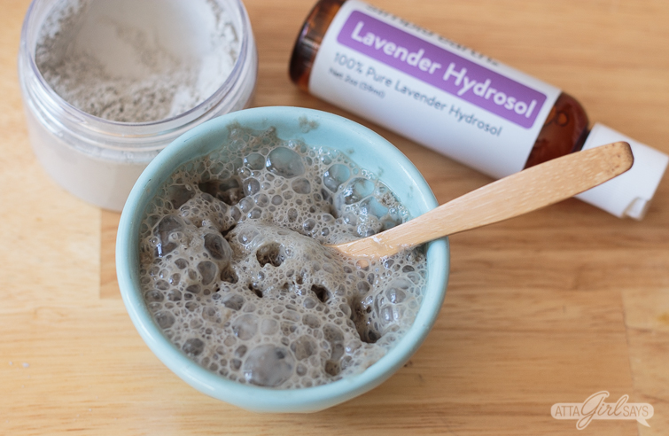 bubbling clay beauty mask in a blue bowl made with lavender hydrosol