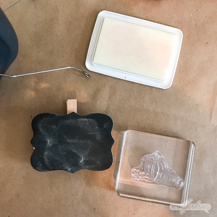 stamp and embossing ink pad with a chalkboard clip