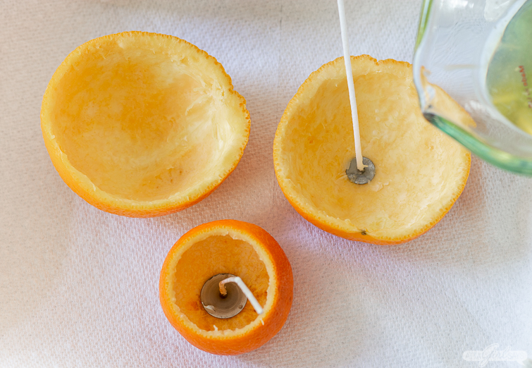 placing wicks in orange peel candles