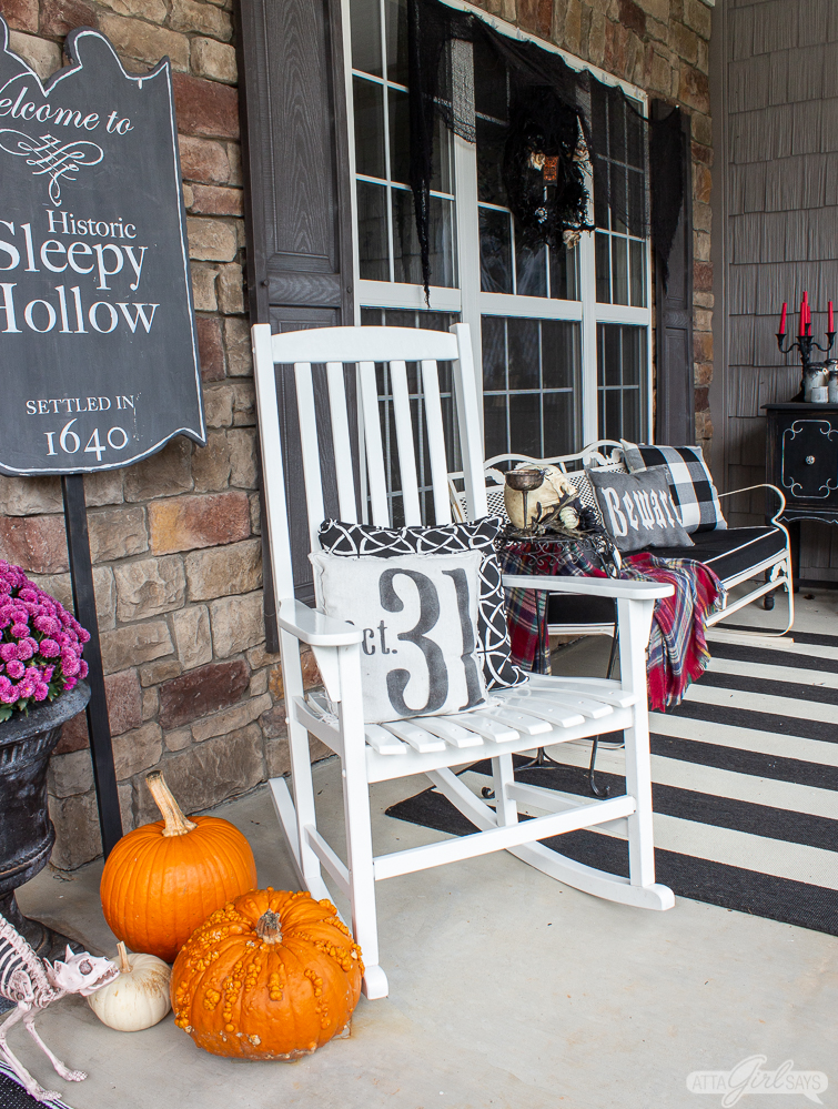 rocking chair and Sleepy Hollow sign on a front porch for Halloween
